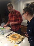 Kyle and Jessica making a Buffalo Chicken Wreath for NYE. Tasty!